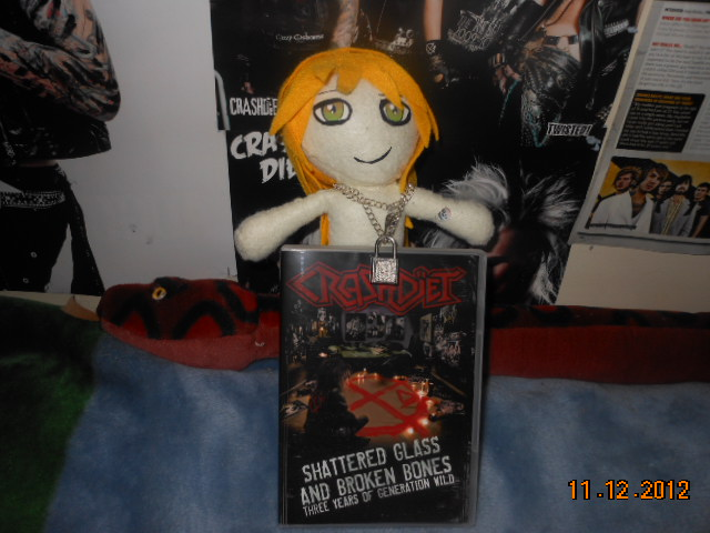 peter-london-plushie-holding-the-dvd.JPG